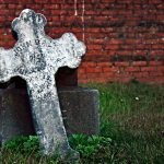 Stone cross in cemetery.